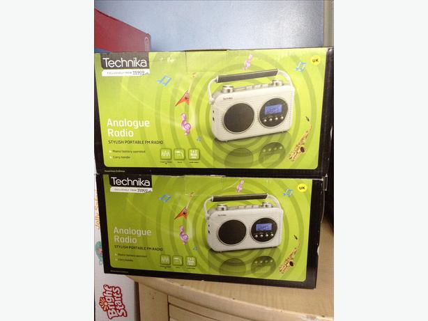 6 Stylish portable radio sets brand new in boxes.