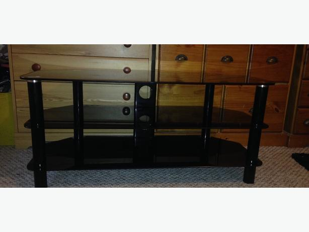 Black glass tv / media unit with 3 shelves and holes for cable organistion.