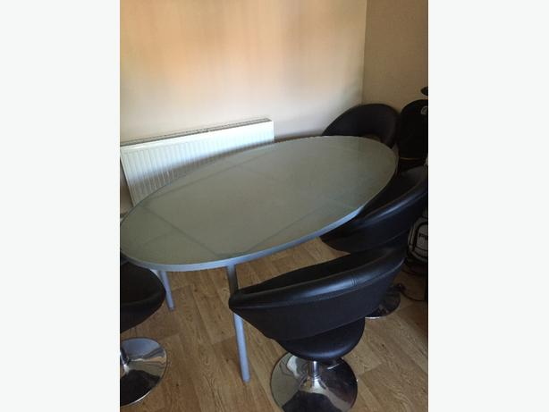 4x bucket chair and oval glass top table