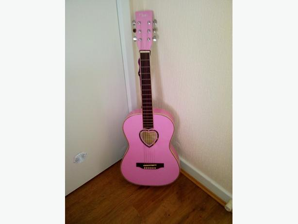 Pink guitar with picks bag and tuner £10 ono