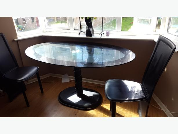 black glass table and X4 chairs