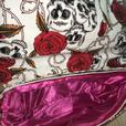 Satchel bag with skull and roses pattern