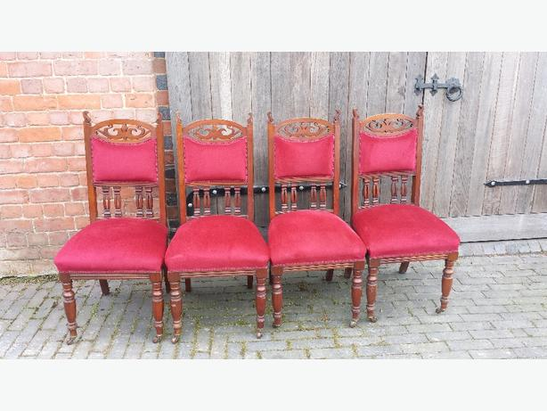 4 Antque dining room chairs.