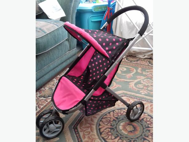 Little girls dolls push chair