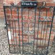 Victorian garden gate in heavy black metal
