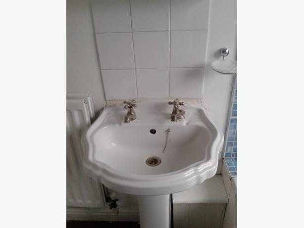 White bathroom sink & toilet set.