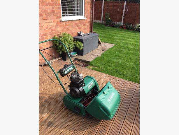 qualcast classic 35s petrol mower with roller