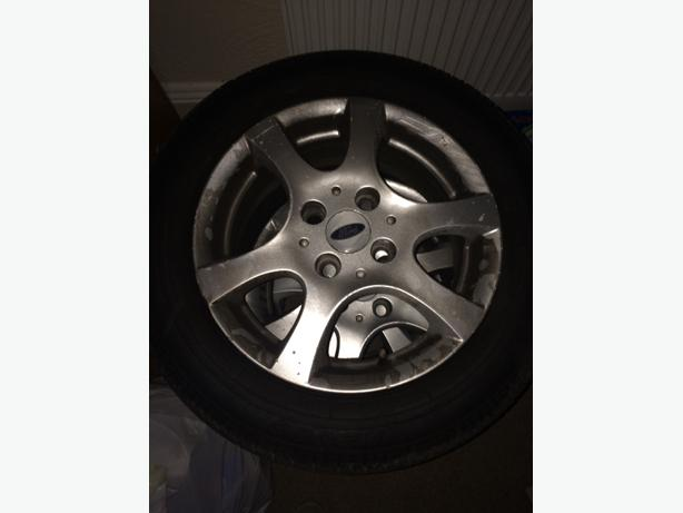 Set of Ford wheels with brand new tyres.