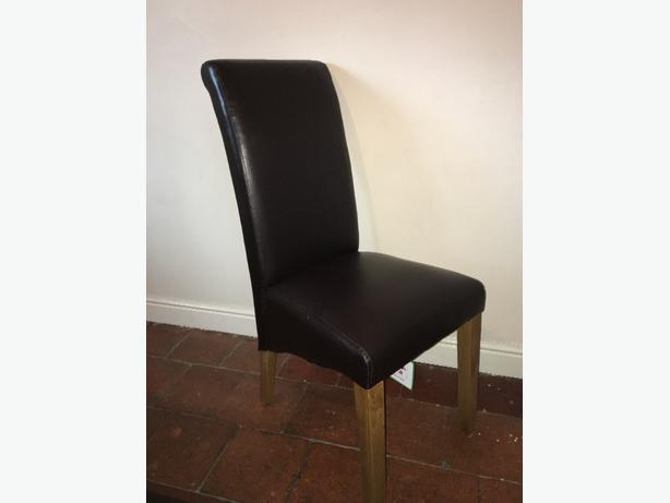 Five leather dining chairs