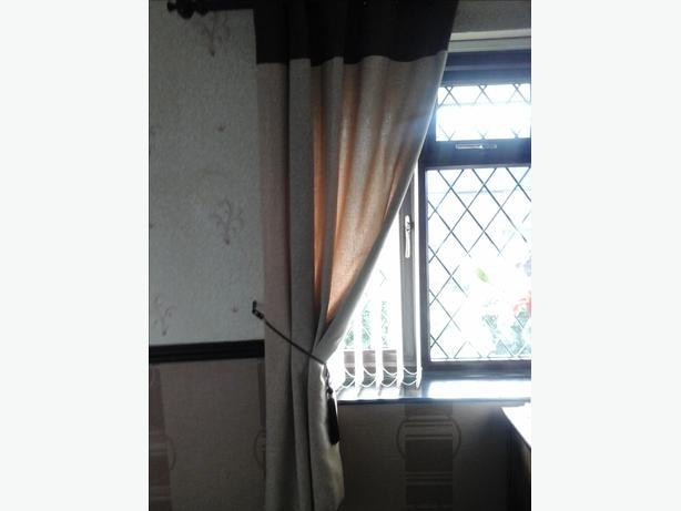 Heavy tab curtain with tie backs