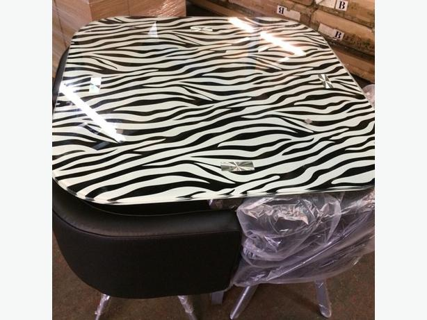 Zebra print dining table and chairs