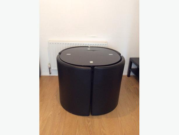 blak glass table with 4 lethar chair