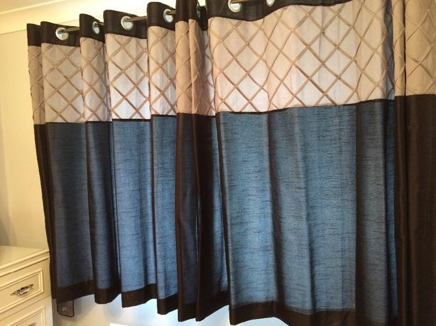 black and silver curtains with tie back and silver black cushions