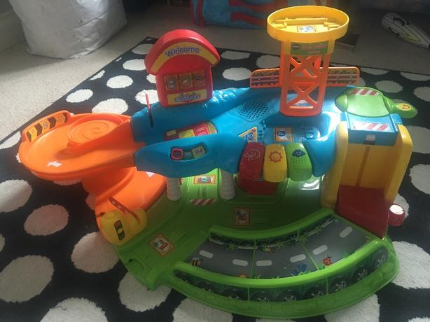 V Tech Toot Toot Drivers Garage, Deluxe Track Set and Cars