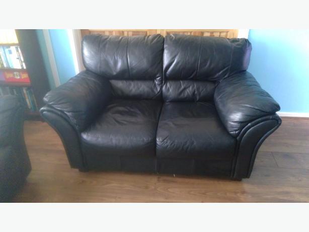 **2 black leather sofas**