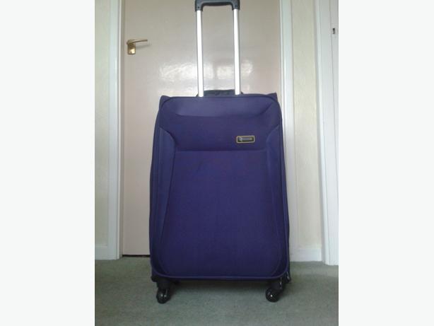Revelation Lightweight Expandable 4 Wheeled Large Purple Suitcases.