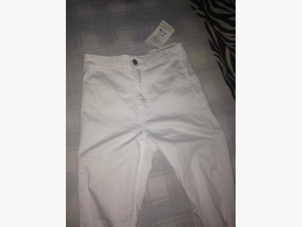 womens white highwaisted jeans with slits
