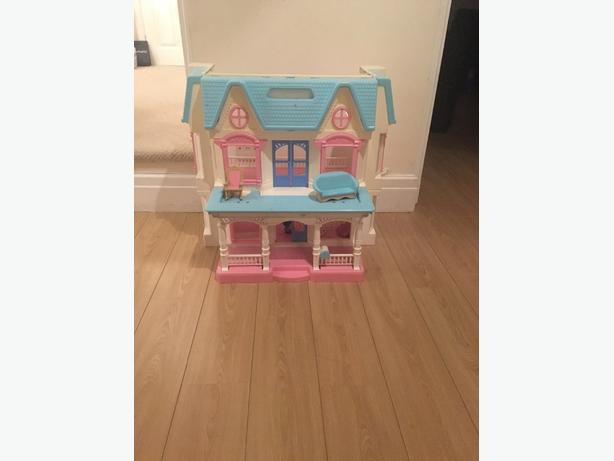 fisher price dolls house with some furniture
