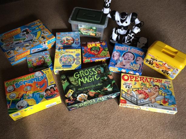 selection of board games, puzzles and figures