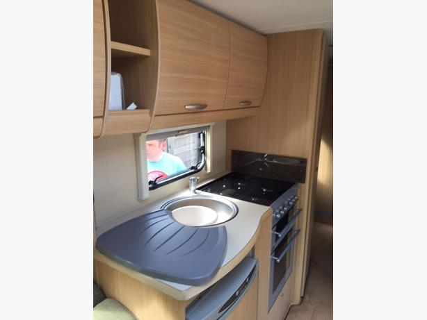 Abbey Expression 540 4 berth Caravan with fixed bed and awning.