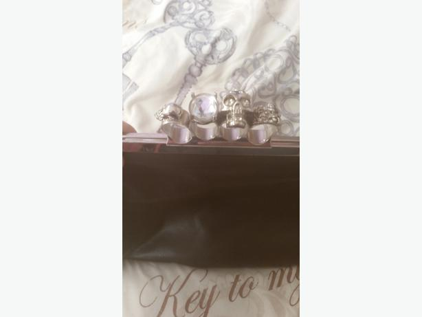 knuckle duster clutch bag