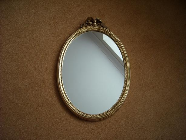 Gilt framed oval mirror