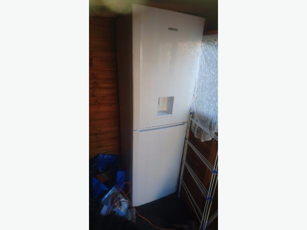 fridge freezer with drinks dispenser