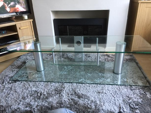 Solid glass television stand, clear glass