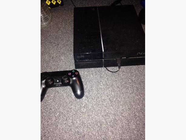 Black ps4 with 4 games