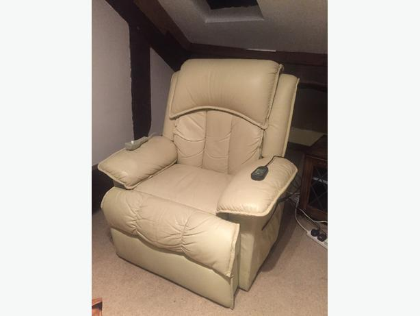 2x cream leather, remote recliners and back massagers - mint condition.