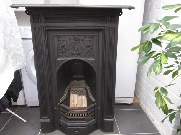 Black cast iron fireplace.