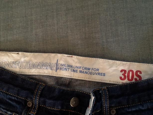 Peaceful hooligan button fly jeans