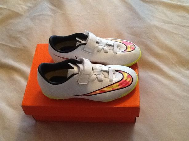 Childs white Nike trainers