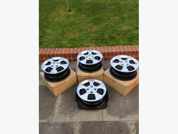"kia 14"" steel rims & trims"