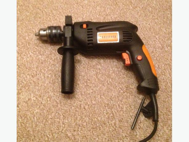 Electric hammer drill with carry case and instructions