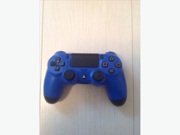 PLAYSTATION 4 WIRELESS BLUE CONTROLLER.