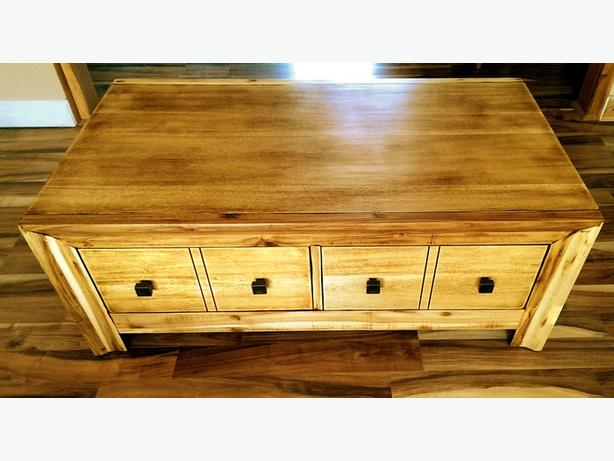 Large, wooden coffee table.