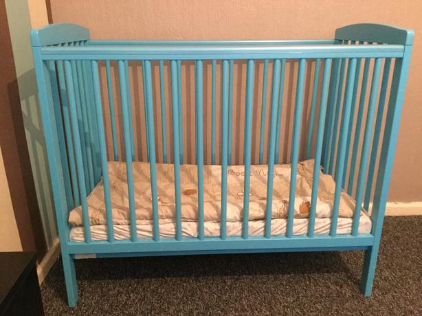Baby boys blue cot