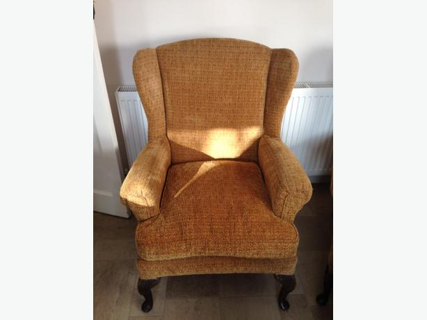 pair of winged back arm chairs