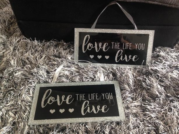 black and glittersilver glass wall plaques