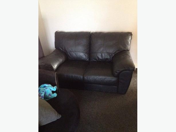 Black Leather 2 seater in excellent condition 4 months old