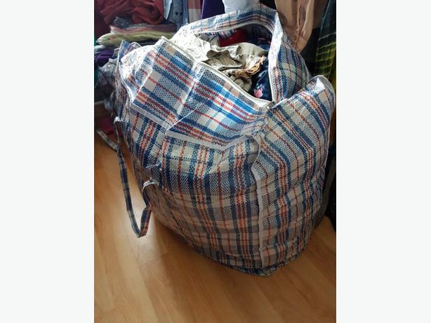 massive bundle of women's clothes. 6-18