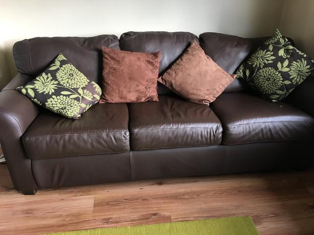 Dark brown three seater leather sofa