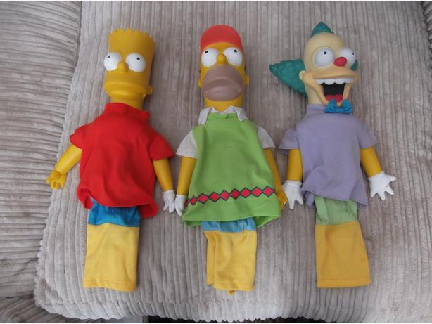 rare Simpsons golf head covers.