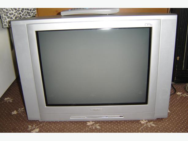 COLOUR TV IS SILVER 21 INCH
