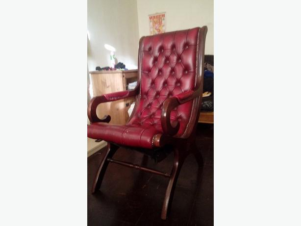 oxblood chesterfield wooden armchair