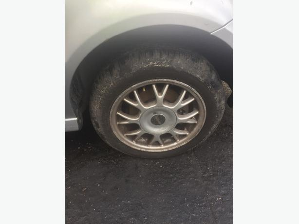 "VW POLO 4 STUD ALLOY WHEELS 14"" X 4 INCLUDES USED TYRES"