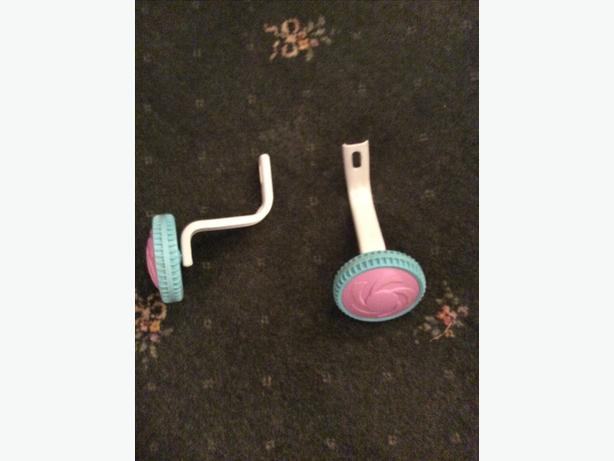Pair of stabilisers for little bike and pink cycle helmet