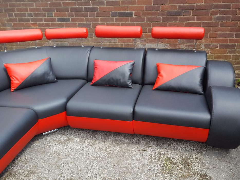 1 month old black and red leather large corner sofa