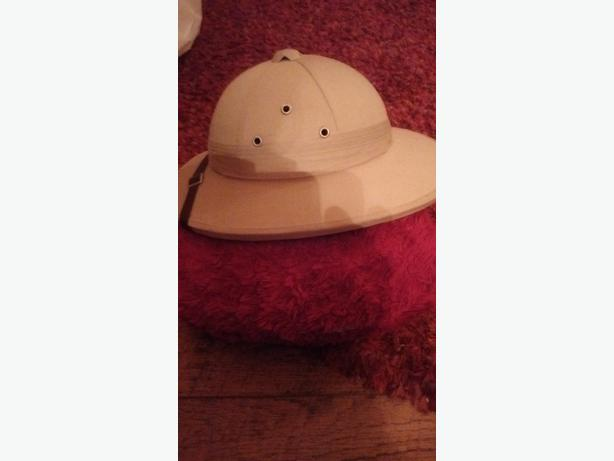 pith helmet and plastic pipe